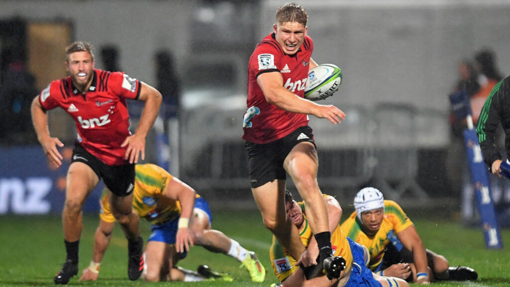 Crusaders back to winning ways as Rebels rout Sharks
